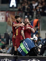 Football Soccer: UEFA Champions League AS Roma vs Chelsea Stadio Olimpico Rome, Italy, October 31, 2017. <br /> Roma's Diego Perotti (c) celebrates with his teammates Federico Fazio (l) and Daniele De Rossi (r) after scoring during the Uefa Champions League football soccer match between AS Roma and Chelsea at Rome's Olympic stadium, October 31, 2017.<br /> UPDATE IMAGES PRESS/Isabella Bonotto