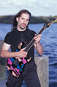 WANTAGH NY - AUGUST 09: John Petrucci of Dream Theater poses for a portrait at The Jones Beach Amphitheater on August 9, 1998 in Wantagh, New York. Photo by Larry Marano © 1998