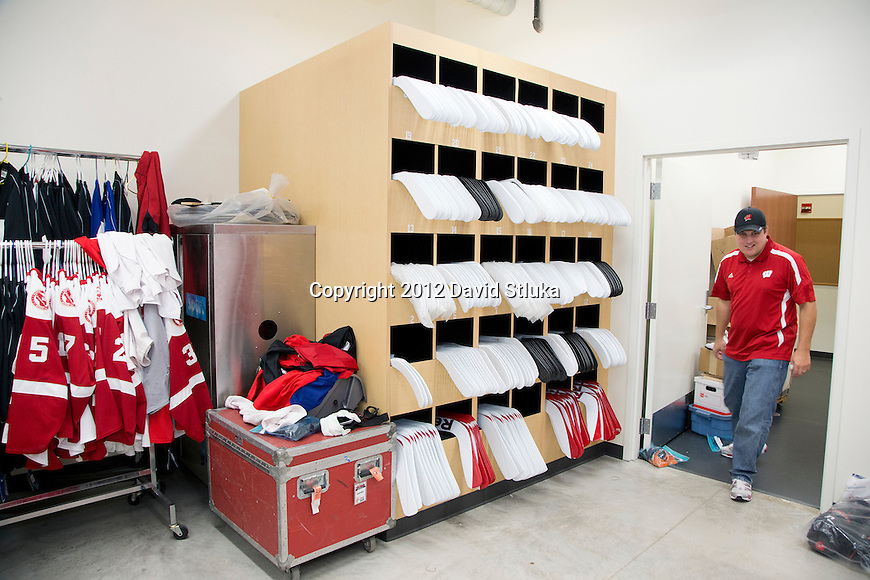 Wisconsin Badgers Menu0027s Hockey Equipment Manager Nate LaPoint Walks Into  The Storage Room On Move