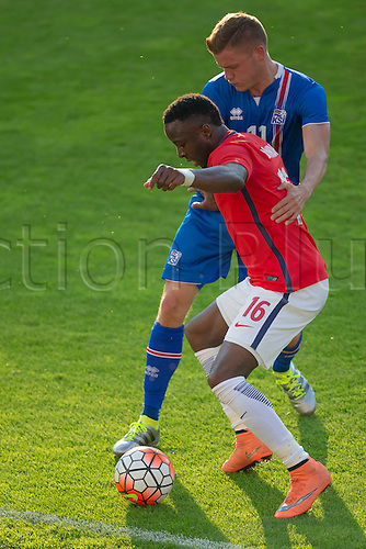 01.06.2016  Ullevaal Stadion, Oslo, Norway.  Adama Diomande of Norway  competes for the ball against  Alfred Finnbogason of Iceland during the International Football Friendly  match between Norway and Iceland in Ullevaal Stadion in Oslo, Norway.