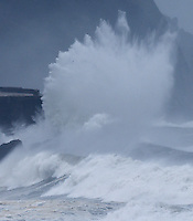 A picture taken on February 10, 2016 shows waves hitting a retaining wall in the Basque city of Donostia. Alerts have been issued for dangerous waves along the Basque coast. PHOTO/ ANDER GILLENEA