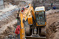An earthmover works in a construction site in Xian, Shaanxi, China.
