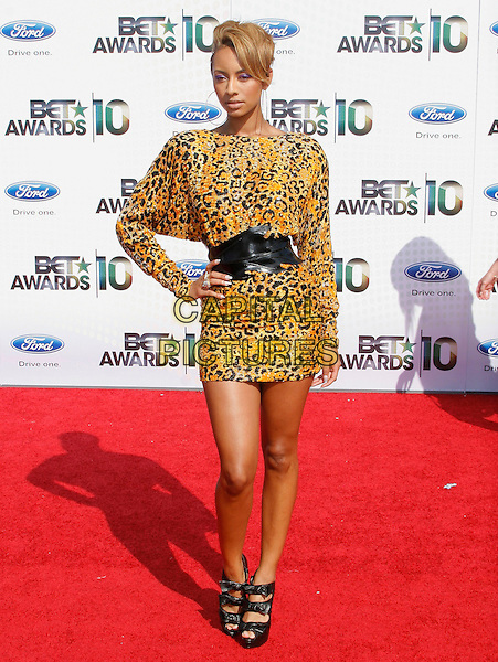 KERI HILSON.The 2010 BET Awards at the Shrine Auditorium in Los Angeles, California, USA. .June 27th, 2010 .full length yellow black leopard print dress hand on hip belt strappy sandals .CAP/RKE/DVS.©DVS/RockinExposures/Capital Pictures.