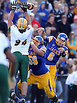 BROOKINGS, SD - SEPTEMBER 28:  Austin Sumner #6 from South Dakota State University passes over the defense of  Danny Luecke #94 from North Dakota State University in the first quarter of their game Saturday afternoon at Coughlin Alumni Stadium in Brookings. (Photo by Dave Eggen/Inertia)
