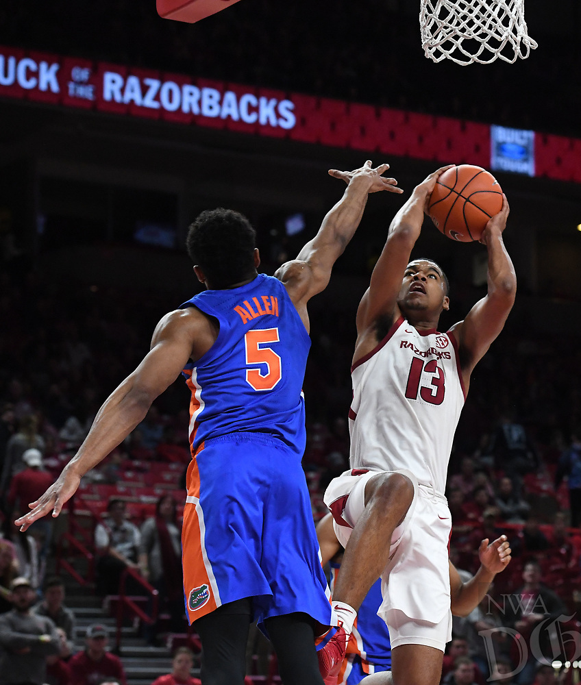 NWA Democrat-Gazette/J.T. WAMPLER Arkansas' Mason Jones takes a shot while Florida's Kevaughn Allen defends Wednesday Jan. 9, 2019 at Bud Walton Arena in Fayetteville. Arkansas lost 57-51.