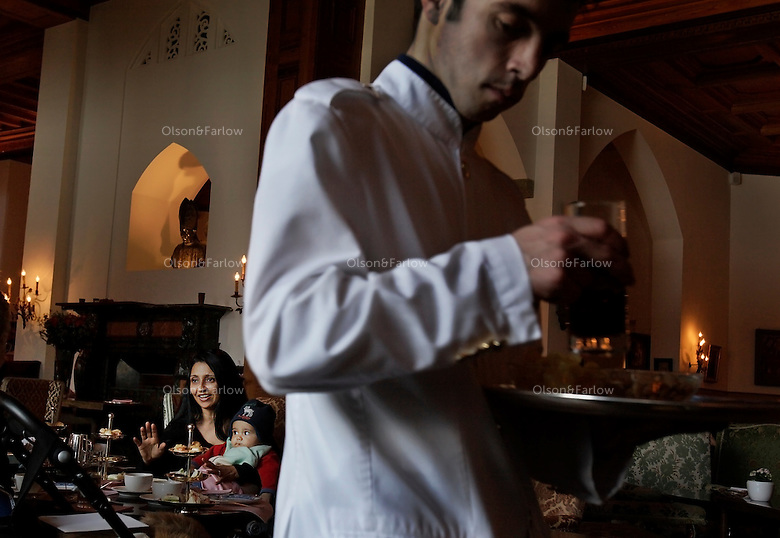 Afternoon tea and preparations for a cocktail party at the Palace Hotel in St Moritz, Switzerland.  <br /> Vinita Sharma and son Prince Jason A. Zinzuwadie