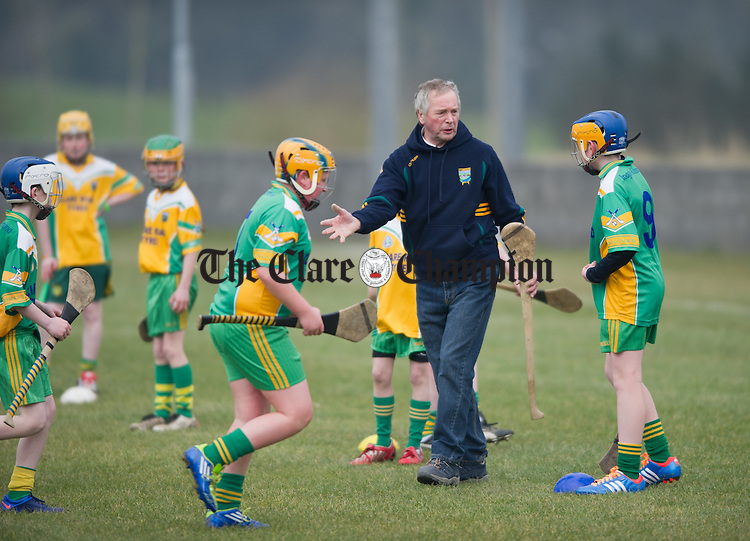 Inagh-Kilnamona's Johnny O Rourke who has been chosen to receive a GAA Presidential Award at a function next week pictured training some of the local school children who benefit from his help. Photograph by John Kelly.