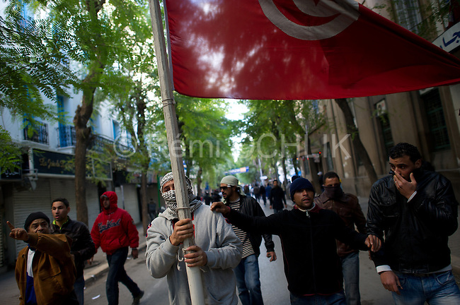 © Remi OCHLIK/IP3 - Tunis the 14 january 2011 - Tunisia riots continued as President Zine El Abidine Ben Ali decided to dismiss his government following massive riots. The country's state news agency TAP says the president plans to call for new election in the next six months. Thousands of protestors took to the streets. The riots were sparked by high unemployment rates and a sagging economy as well as anger over government corruption. Tunisians enjoy little freedoms under President Zine El Abidine Ben Ali who has ruled a repressive regime for 23 years. Protestors ransacked buildings and threw rocks. Police used tear gas and gunshots to quell the crowd as protests got increasingly violent...