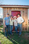 The Busi family, Ty, Collet, Kelsi and Frank with their newly-branded pump shed near their corrals near Jackson, California.