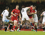 Jamie Roberts of Wales tackled by George Ford and Chris Robshaw of England - RBS 6Nations 2015 - Wales  vs England - Millennium Stadium - Cardiff - Wales - 6th February 2015 - Picture Simon Bellis/Sportimage