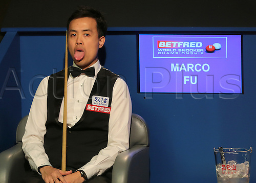 30.04.2016. The Crucible, Sheffield, England. World Snooker Championship. Semi Final, Mark Selby versus Marco Fu. Marco Fu reacts to his missed pot