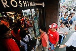 Hiroshima Carp baseball team fans enter to Hiroshima Brand Shop TAU in Ginza on September 11, 2016, Tokyo, Japan. Hundreds of Carps fans lined up from early morning outside Hiroshima Brand Shop TAU to buy victory t-shirts after Hiroshima baseball team got its first Central League title in 25 years after beating the Yomiuri Giants 6-4 on Saturday, September 10. (Photo by Rodrigo Reyes Marin/AFLO)