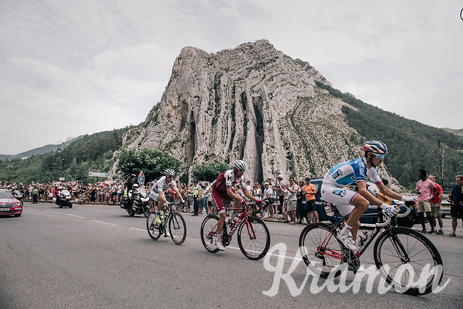 riders from the breakaway group riding through the town of Sisteron with it's distinctive monumental rock formations<br /> <br /> 104th Tour de France 2017<br /> Stage 19 - Embrun &rsaquo; Salon-de-Provence (220km)