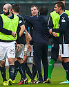 Dundee's David Clarkson gets a hug from Dundee manager Paul Hartley at the end of the game.