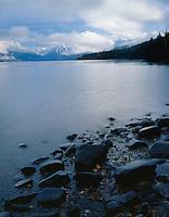 Lake McDonald shore & snowy peaks in fall,GLACIER NATIONAL PARK, Montana