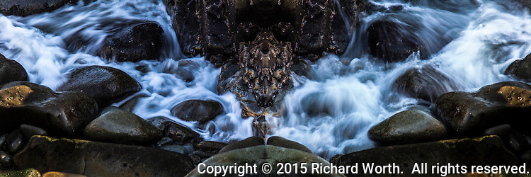 Two photographs of waves flowing onto rocks at Bean Hollow State Beach are softened and blurred by slow shutter speed then combined into a single image with what looks like a dragaon head at its center.