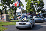 Flags flew at half staff at Ninevah Christian where the funeral for Kentucky State Trooper Eric Keith Chrisman was laid to rest Monday June 29, 2015 in Lawrenceburg, Ky.  He died in the the line of duty June 23, 2015.  Police officers and Fire fighters from across Kentucky and the Nation came to pay respects to his family.  Photo by Mark Mahan