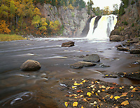 Tettegouche State Park, MN   <br /> High Falls on the Baptism River with fall colored birch trees at the river's edge