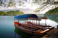 Lake Bled flat bottomed barge called a Pletna.  . Lake Bled Slovenia.