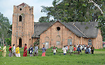 Residents of the Congolese village of Wembo Nyama walk from a worship service in the United Methodist Church.