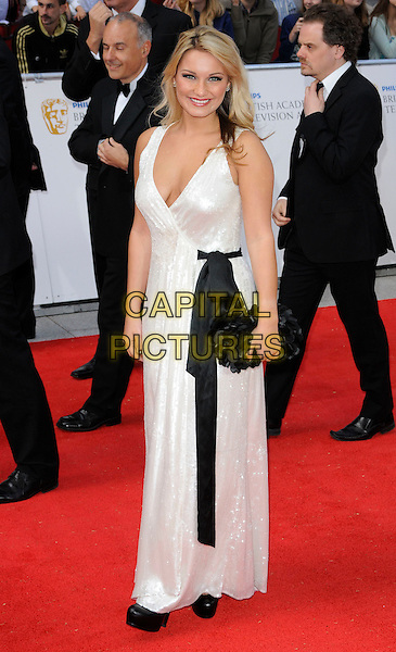SAM FAIERS .The Philips British Academy Television Awards, Grosvenor house Hotel, Park Lane, London, England, UK, May 22nd 2011..arrivals TV Baftas Bafta full length white dress black bow sash waist clutch bag maxi.CAP/CAN.©Can Nguyen/Capital Pictures.