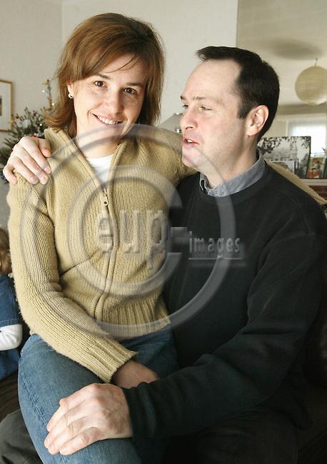 BELGIUM, Antwerpen / 15 December 2002--The Robertson family. Sopie and Mark Robertson in their home..PHOTO: JUHA ROININEN