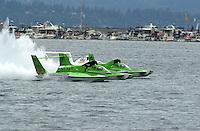 The U-100, U-99 (center) and the U-9 charge the starting line..Hydro-PROP Seafair,Lake Washington,. Seattle, Washington, USA. 5 August,2001.Copyright©F.Peirce Williams 2001..F. Peirce Williams .photography.P.O.Box 455  Eaton, OH 45320 USA.p: 317.358.7326  fpwp@mac.com