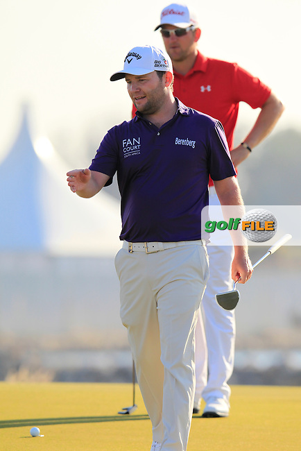 Branden GRACE (RSA) and Bernd Wiesberger (AUT) on the 15th green during Saturday's Final Round of the 2015 Commercial Bank Qatar Masters held at Doha Golf Club, Doha, Qatar.: Picture Eoin Clarke, www.golffile.ie: 1/24/2015