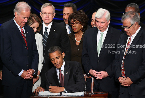United States President Barack Obama signs the Dodd-Frank Wall Street Reform and Consumer Protection Act at the Ronald Reagan Building, Wednesday, July 21, 2010 in Washington, DC. The bill is the strongest financial reform legislation since the Great Depression and also creates a consumer protection bureau that oversees banks on mortgage lending and credit card practices. Also pictured (L-R) are Vice President Joe Biden, Speaker of the House Nancy Pelosi (D-CA), Senate Majority Leader Harry Reid (D-NV), Rep. Maxine Waters (D-CA), Sen. Chris Dodd (D-CT) and Rep. Barney Frank (D-MA). .Credit: Win McNamee - Pool via CNP