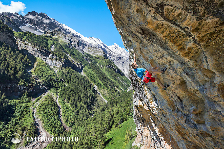 Daniel Hulliger sport climbing on the steep limestone walls of Gimmelwald, Switzerland, Route is Gimmelexpress 8c/8c+