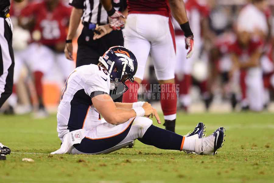 Aug. 30, 2012; Glendale, AZ, USA; Denver Broncos quarterback (16) Caleb Hanie reacts after being sacked by the Arizona Cardinals during a preseason game at University of Phoenix Stadium. Mandatory Credit: Mark J. Rebilas-