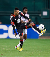 Lionard Pajoy (26) of D.C. United fights for the ball with Khari Stephenson (23) of Real Salt Lake during the game at RFK Stadium in Washington, DC.  D.C. United defeated Real Salt Lake, 1-0.