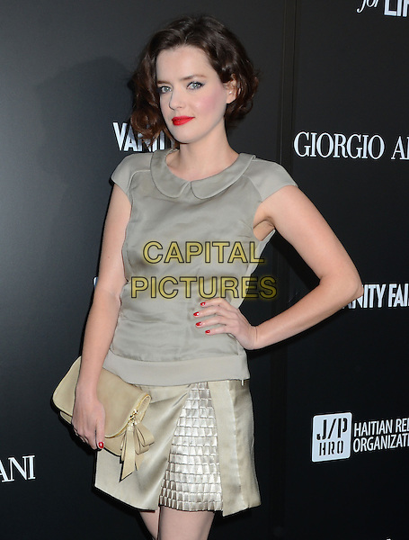 Roxanne Mesquida.Attending the Giorgio Armani party to celebrate Paris Photo Los Angeles at Paramount Studios, Hollywood, California, USA, .25th April 2013..half length grey gray hand on hip beige clutch bag gold shiny collar peter pan top skirt .CAP/ADM/BT.©Birdie Thompson/AdMedia/Capital Pictures
