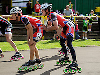 11 AUG 2013 - BIRMINGHAM, GBR - James Ashby (left)  of Wisbech Inline Speed Skating Club is propelled forward at the changeover by team mate Michael McInerney (right) during the Junior and Senior Men's 3000m Relay at the Federation of Inline Speed Skating 2013 British Outdoor Championships at Birmingham Wheels Park in Birmingham, West Midlands, Great Britain (PHOTO COPYRIGHT © 2013 NIGEL FARROW, ALL RIGHTS RESERVED)