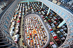 Bangladeshi Muslims offer Jumma prayers at the the National Mosque of Bangladesh, Baitul Mukarram in Dhaka, Bangladesh.