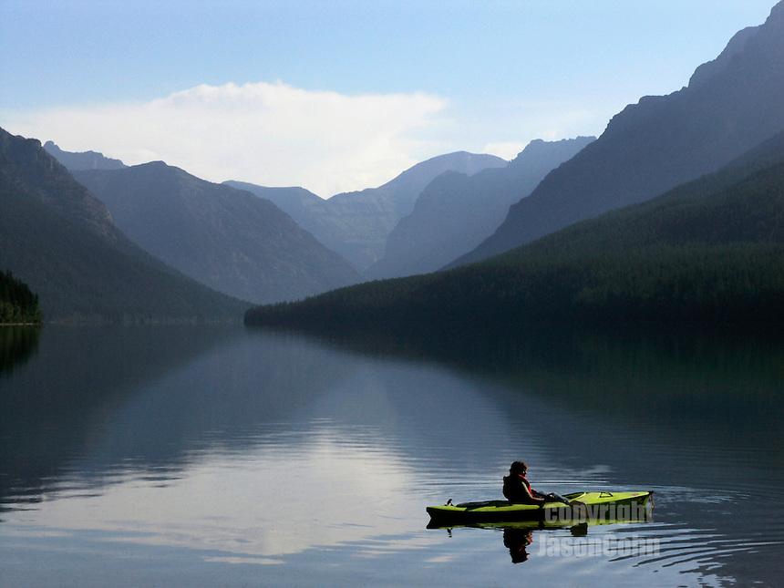 A kayaker on Bowman Lake in Glacier Park, Montana. Photo by Jason Cohn
