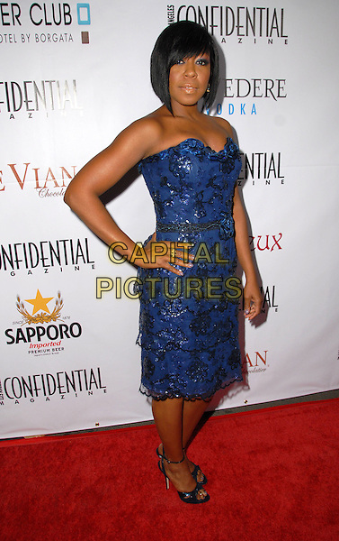 TICHINA ARNOLD .Los Angeles Confidential Magazine Anual Emmy Pre-Party, held At Les Deux, Hollywood, California, USA..September 20th, 2008.full length blue strapless dress hand on hip .CAP/ADM/FS.©Faye Sadou/AdMedia/Capital Pictures.
