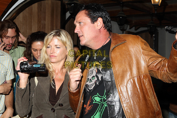 "Deanna & Michael Madsen.Producing the movie ""The Prophet: Mission of the fifth angel"", Moscow, Russia..August 30th, 2007.half length black leather jacket top brown video camera married husband wife profile recording.CAP/PER/AL.©AL/PersonaStars/CapitalPictures"