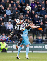 Stanley Aborah of Notts County beats Paul Hayes of Wycombe Wanderers to the ball during the Sky Bet League 2 match between Notts County and Wycombe Wanderers at Meadow Lane, Nottingham, England on 28 March 2016. Photo by Andy Rowland.