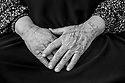 """Zubeyda Ali, 60, who fled Kobani with her whole family, including ten married children and 25 grandchildren, was tattooed at the age of 13. She has a large tattoo on her left hand and some small inverted """"v"""" tattoos on her chin. Her husband, Nuh Shahin, says """"all the men loved girls with tattoos."""" They married when she was 13 and he was 20."""