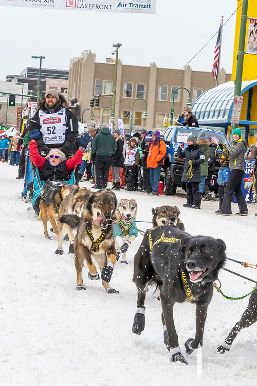 Damon Ramaker and team leave the ceremonial start line with an Iditarider and handler at 4th Avenue and D street in downtown Anchorage, Alaska on Saturday March 7th during the 2020 Iditarod race. Photo copyright by Cathy Hart Photography.com