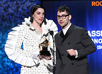 "Annie Clark, also known as St. Vincent, left, and Jack Antonoff accept the award for best rock song for ""Masseduction"" at the 61st annual Grammy Awards on Sunday, Feb. 10, 2019, in Los Angeles. (Photo by Matt Sayles/Invision/AP)"