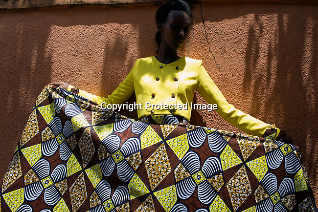 KIGALI, RWANDA NOVEMBER 6: A model fits a dress a few days before the gala night at Kigali Fashion week on November 6, 2014 held at Kigali City Towers in Kigali, Rwanda. Designers from Rwanda, Burundi and Uganda showed their latest collections at the yearly event. (Photo by: Per-Anders Pettersson)