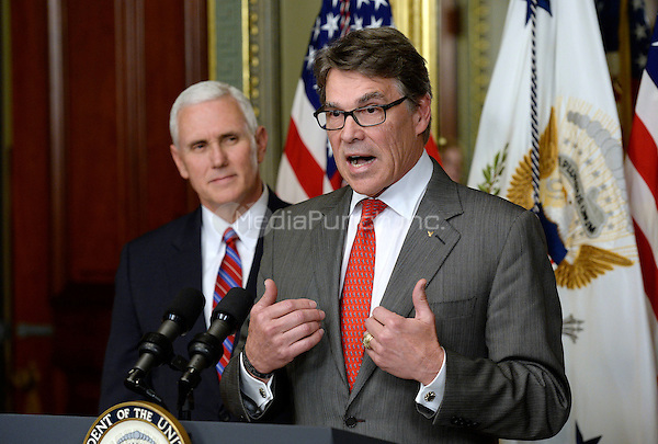 Former Governor Rick Perry (Republican of Texas), right, makes remarks after being sworn-in to be United States Secretary of Energy by US Vice President Mike Pence, left, on March 2, 2017 in Washington, DC. <br /> Credit: Olivier Douliery / Pool via CNP /MediaPunch