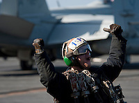 120522-N-DR144-553 .PACIFIC OCEAN (May 21, 2012) Aviation Structural Mechanic Airman Joshua Kelly, assigned to Strike Fighter Squadron (VFA) 22, celebrates another launch as pilots and aircraft assigned to Carrier Air Wing (CVW) 17 depart the flight deck of the Nimitz-class aircraft carrier USS Carl Vinson (CVN 70) and return to their home bases after nearly six months embarked. Carl Vinson and CVW 17 recently completed a deployment to the U.S. 5th and 7th Fleet areas of operations. (U.S. Navy photo by Mass Communication Specialist 2nd Class James R. Evans/Released).