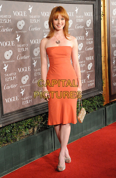 "ALICIA WITT .at The 2nd Annual Art of Elysium Black Tie Charity Gala ""Heaven"" held at The Vibiana in Los Angeles, California, USA,  January 10th 2009.                                                                     .full length strapless orange coral dress  gold bag silver shoes sandals .CAP/DVS.©Debbie VanStory/Capital Pictures"