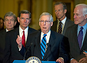 United States Senate Majority Leader Mitch McConnell (Republican of Kentucky), center, speaks to reporters following the Republican Party luncheon in the United States Capitol in Washington, DC on Tuesday, July 11, 2017.  From left to right: US Senator Roy Blunt (Republican of Missouri), US Senator John Barrasso (Republican of Wyoming), Leader McConnell, US Senator John Thune (Republican of South Dakota) and US Senator John Cornyn (Republican of Texas).  In his remarks, McConnell announced he will keep the Senate in session for the first two weeks of August, delaying their summer recess.<br /> Credit: Ron Sachs / CNP