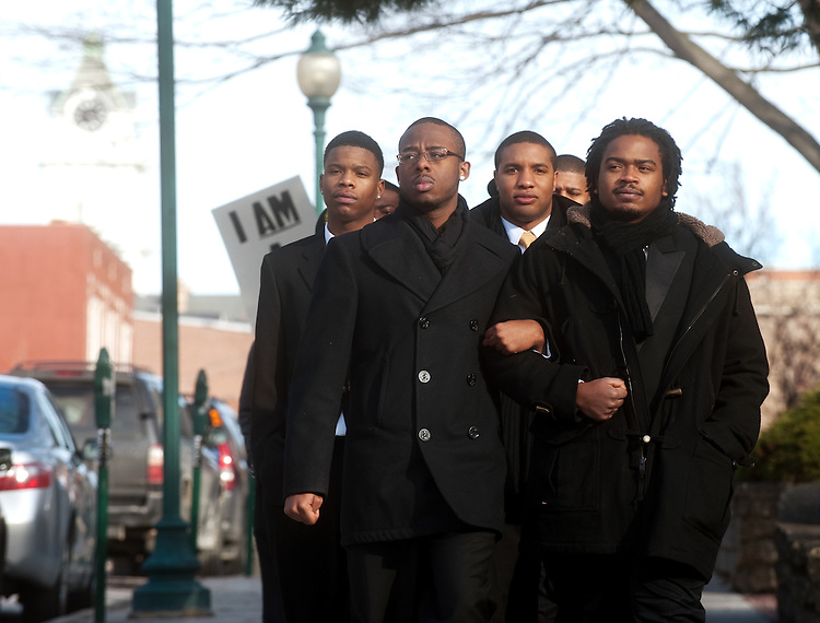 Ohio University students Arthur Green (Front Left) and Donald Lindsay (Front RIght) participate in the 11th Annual Martin Luther King, Jr. Silent March & Brunch Monday.