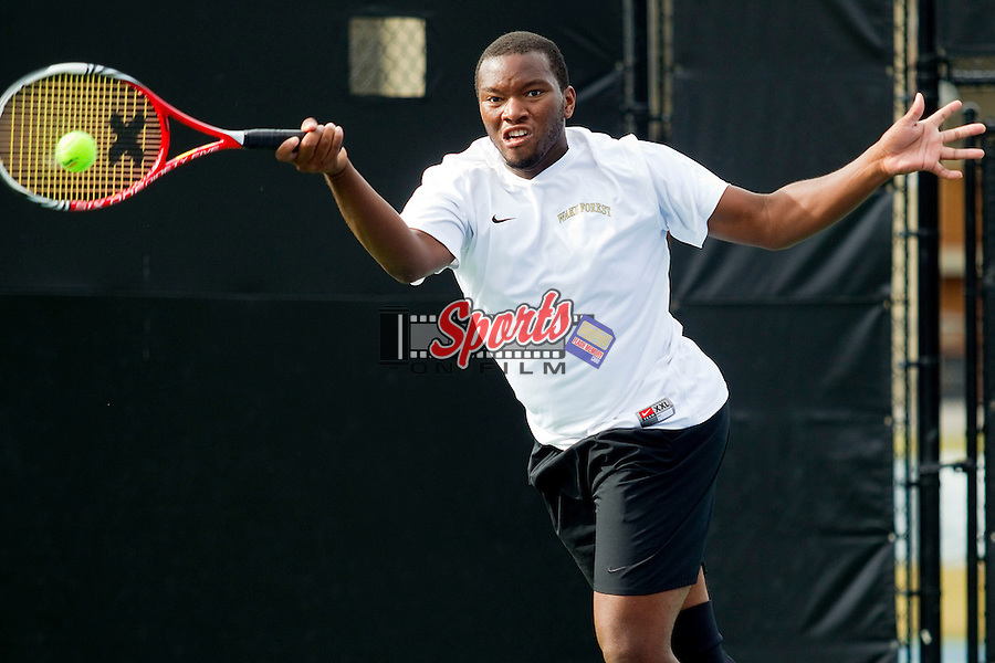 David Hopkins of the Wake Forest Demon Deacons returns the ball at the Wake Forest Tennis Center on October 12, 2012 in Winston-Salem, North Carolina.  (Brian Westerholt/Sports On Film)