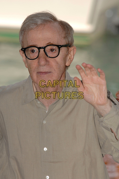 "WOODY ALLEN.Photocall for ""Cassandra's Dream"" at the 64th Venice Film Festival (La Biennale di Venezia), Venice, Italy..September 2nd, 2007 .half length hand palm waving glasses beige shirt .CAP/PL.©Phil Loftus/Capital Pictures"